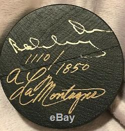 BOBBY ORR autographed puck carved from the wood used in his famous statue
