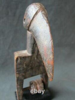 Genuine wooden heddle pulley from the Senufo, Ivory Coast